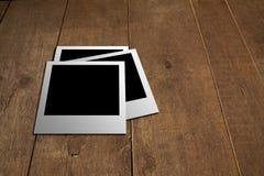Polaroid sul pavimento di legno Immagine Stock Libera da Diritti