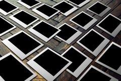 Polaroid sul pavimento di legno Immagini Stock Libere da Diritti