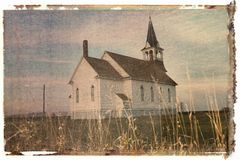 Polaroid transfer of rural church in field. stock image