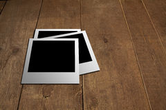 Polaroid on the wooden floor Royalty Free Stock Image