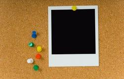 Polaroidabbildung auf Corkboard Stockbild