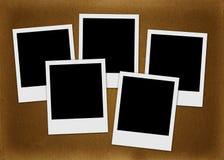 Polaroidcamera's op de bruine achtergrond Stock Afbeelding