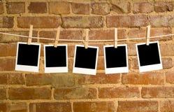 Polaroide auf einem Clotheline Stockbild
