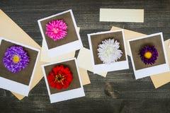Polaroides con los papeles viejos Foto de archivo libre de regalías