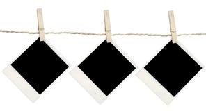 Polaroides en clothespin Fotografía de archivo libre de regalías