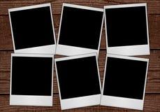 Polaroides en tablones Foto de archivo libre de regalías