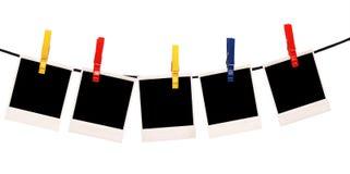 Polaroides en una cuerda Fotografía de archivo libre de regalías