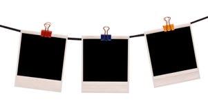 Polaroidfeld auf einem Seil Stockbild