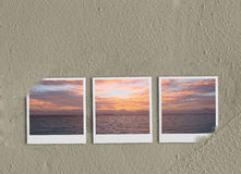 Polaroids collage on sand Stock Image