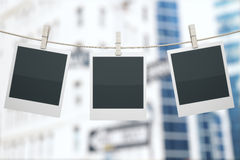 Polaroids on construction. Three blank polaroids hanging on rope with clothespins on construction background. Mock up, 3D Render Royalty Free Stock Photography