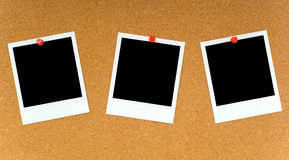 Polaroids on Corkboard Stock Photo