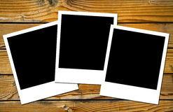 Polaroids frames over wooden boards Stock Photo