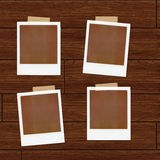 Polaroids Illustration. Polaroids over a wooden background Vector Illustration