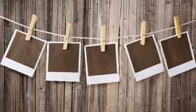 Polaroids. Old prints hanging on rope Royalty Free Stock Photo