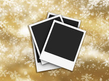 Polaroids on snowflake background Royalty Free Stock Photo