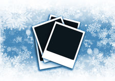 Polaroids on snowflake background Royalty Free Stock Image