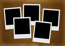 Polaroids sui precedenti marroni Immagine Stock