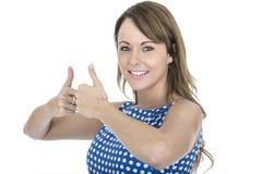 Polca azul que lleva feliz Dot Dress Thumbs Up de la mujer Fotos de archivo libres de regalías