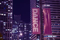 Pole Banners Dance. Double Sided Pole Banners. Night Hours Photography. Urban Theme. Dance Banner Royalty Free Stock Image
