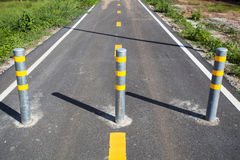 Pole for car and bicycle barriers stock photo