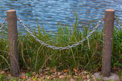 Pole and chain fence. Royalty Free Stock Photos