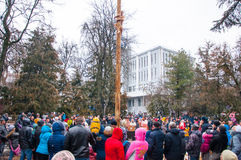 The pole climb on the smooth wooden pole on Maslenitsa, people celebrate holiday in Moscow. Royalty Free Stock Image