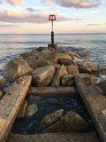 Quay in Bournemouth. A pole on the coast of Bournemouth bay Royalty Free Stock Photos