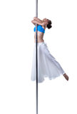 Pole dance. Cute girl dancing, isolated on white Stock Photo
