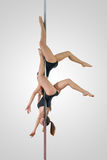 Pole dance duet royalty free stock photo