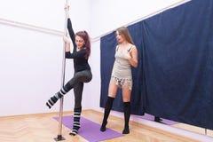 Pole dance exercise Stock Photos