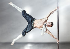 Pole dance man Stock Photography