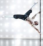 Pole dance man Stock Images