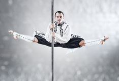 Pole dance man. Young pole dance man. White colors Royalty Free Stock Images