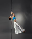 Pole dance. Seductive dancer with perfect body Stock Images