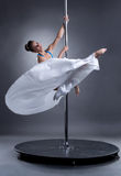 Pole dance. Sexy woman posing in elegant position Stock Image