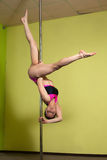 Pole dance trick on the pilon Royalty Free Stock Photography