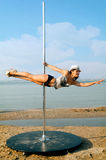 Pole dance woman against sea background. Royalty Free Stock Images