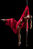 Pole dance woman in red bikini with fabric Royalty Free Stock Images