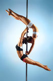 Pole dance women Stock Photos