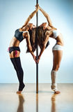 Pole dance women Stock Images