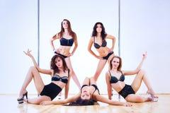 Pole dance women Stock Images