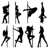 Pole dance women silhouettes Stock Photos