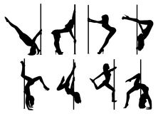 Pole dance women silhouettes Stock Photography