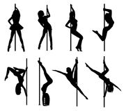 Pole dance women silhouettes Royalty Free Stock Images