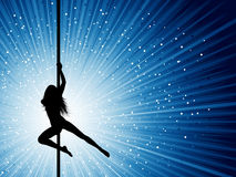 Pole dancer. Silhouette of a sexy pole dancer on a starburst background Stock Photography