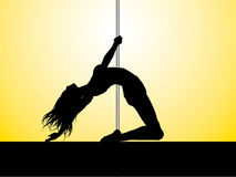 Pole dancer. Silhouette of a pole dancer performing Royalty Free Stock Image