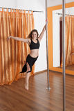 Pole dancer in the flying in the air. Woman training pole dance in relaxed pose Stock Image