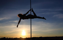 Pole dancer outdoor Royalty Free Stock Image