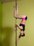 Pole dancer in the pole dance studio Royalty Free Stock Photography