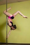 Pole dancer in the pole dance studio Stock Photography